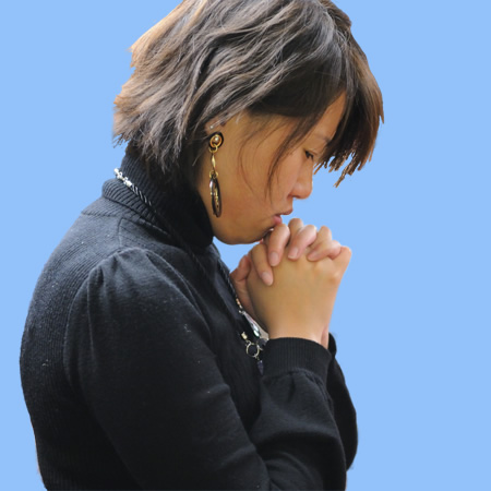 Young Chinese lady in prayer